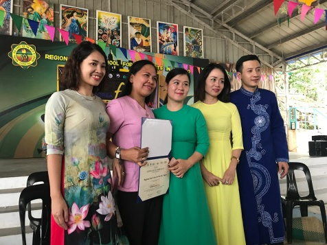 The Regional Lead School for the Arts in Angono receives the certificate of participation from the NCCA and ROK.